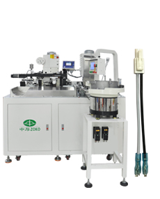 Automatic terminal plastic housing and sleeve inserting machine